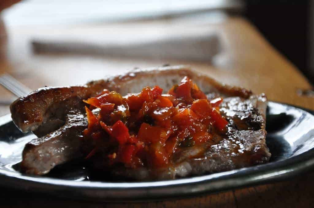 Made for pork chops, this spicy tomato chutney is full of warm spices like cardamom and mustard seeds; a couple of fresh jalapeños bring on the heat.