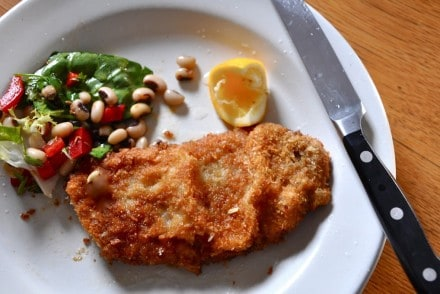 These pork milanesa are tender pork cutlet pounded thin and lightly breaded and fried. Served with a slice of lemon or lime makes a divine dinner on a dime.