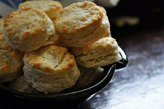 These vegan biscuits made with coconut oil are so good you'll never know there's no butter! They bake up tall with layers of delicate, flaky dough. #biscuits #veganbiscuits #coconutoilbiscuits