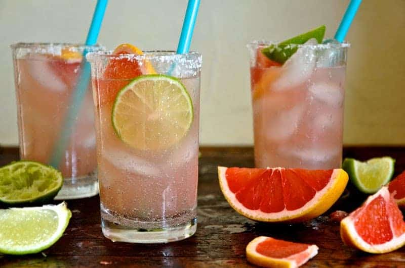 Juicy, pink ruby red grapefruit make a beautiful Honey Grapefruit Margarita sweetened with honey, a hefty splash of tequila, and rimmed in coarse salt.