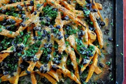 A sheet pan of sweet potato nachos sprinkled with cilantro