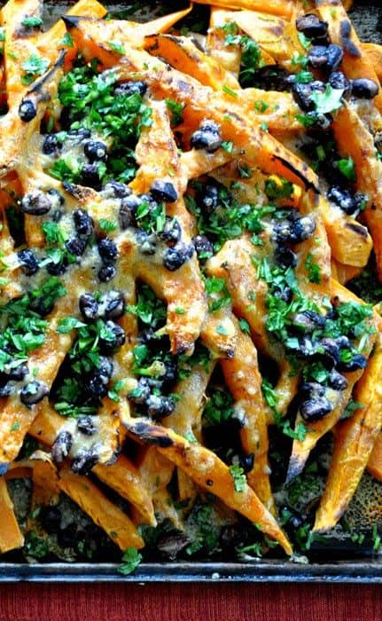 My most popular recipe: Easy, 4-ingredient sweet potato nachos! Baked sweet potato fries get topped with black beans, smoked cheddar cheese, and cilantro.