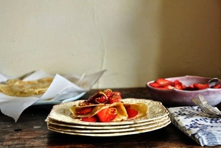 Light as air coconut milk crepes folded over lemon-streaked strawberries and toasted coconut. These dairy-free crepes are a lovely for Mother's Day brunch.
