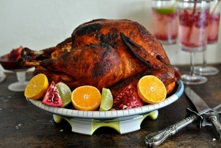 This Mexican-inspired Achiote Roasted Turkey recipe is rubbed with savory achiote paste and citrus then slow roasted to a beautiful bronze. #thanksgiving #turkey #Thanksgivingturkey #turkeyrecipe #holajalapeno