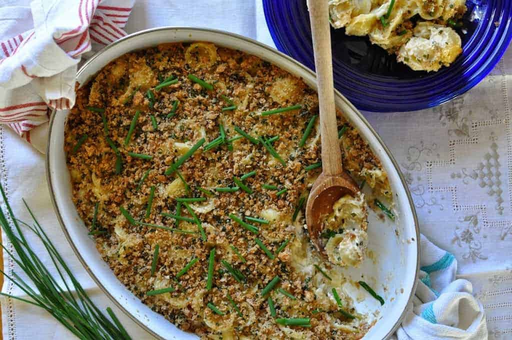 Creamy Green Chile Mac + Cheese is topped with crunchy chive breadcrumbs making for the perfect combo of silky, spicy baked macaroni and a crumbly top.
