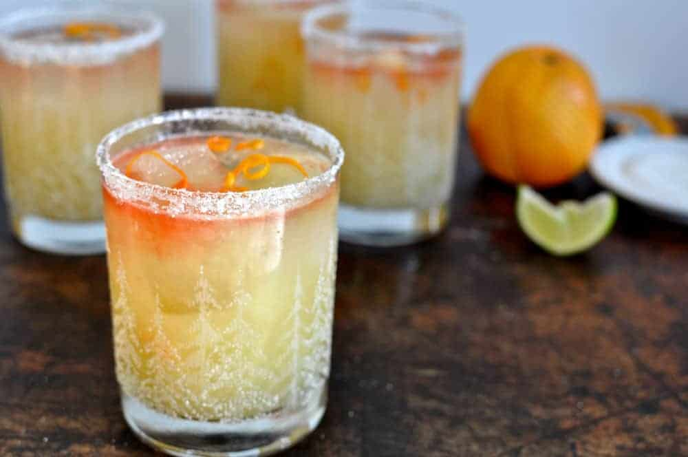 This mezcal margarita is the perfect balance of smoky mezcal, and bright orange flavor from fresh orange zest and the bubbly effervescence of orange soda.