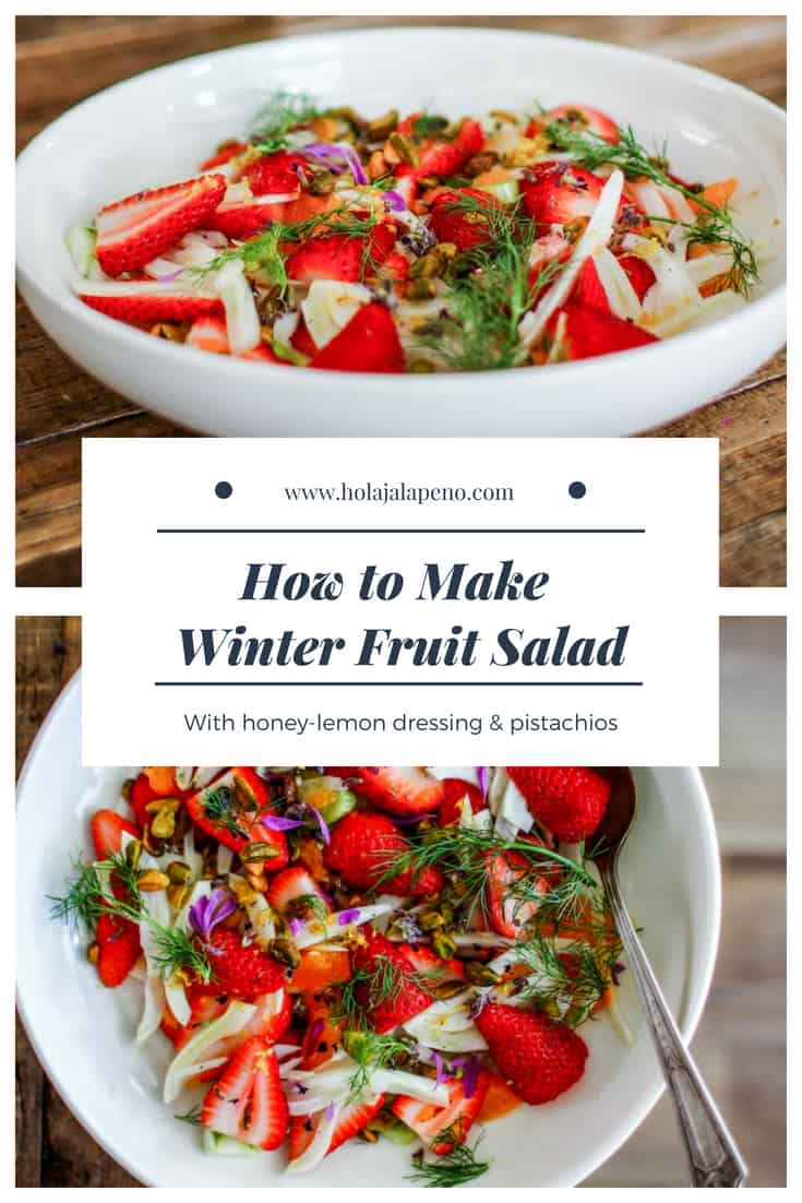 This winter fruit salad is a gorgeous combination of thinly sliced fennel, juicy strawberries, and floral clementines tossed in a lemon and honey dressing and sprinkled with roasted pistachios. #strawberrysalad #fruitsalad #healthyfruitsalad #brunchsalad