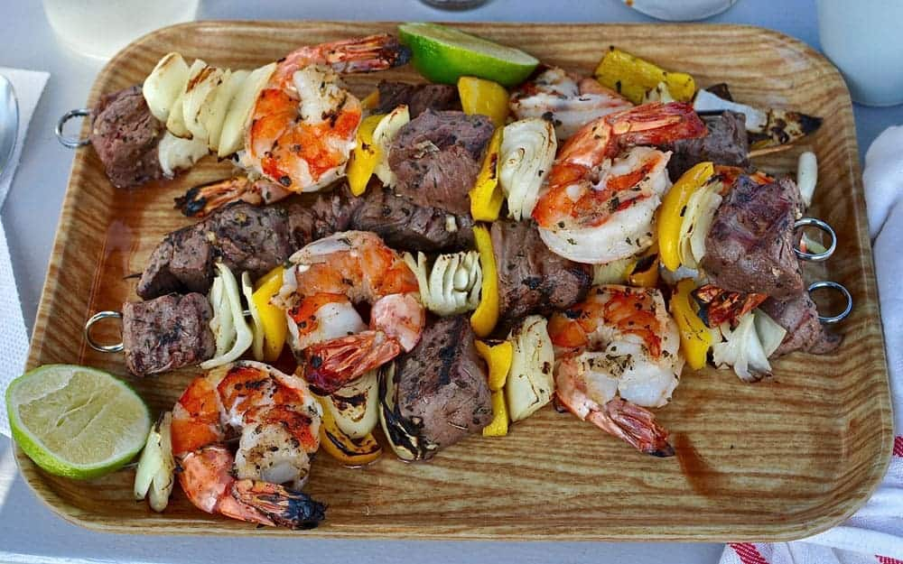 Grilled shrimp and steak kabobs are the ultimate surf and turf summer dinner. Serve with a grilled tomato-chile salsa for the ultimate healthy dinner.