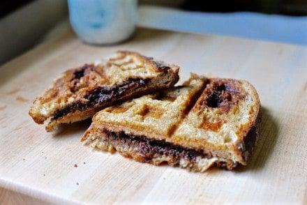 A Chocolate Waffle Iron Sandwich is a fun snack: Chocolate sandwiched between two slices of buttered country bread & toasted in a waffle iron until melted.