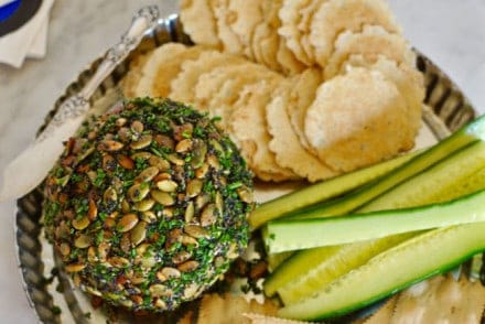 This manchego chipotle cheese ball is perfect for parties; coated with pumpkin and poppy seeds, and chives its a real crowd pleaser. Gluten-free!