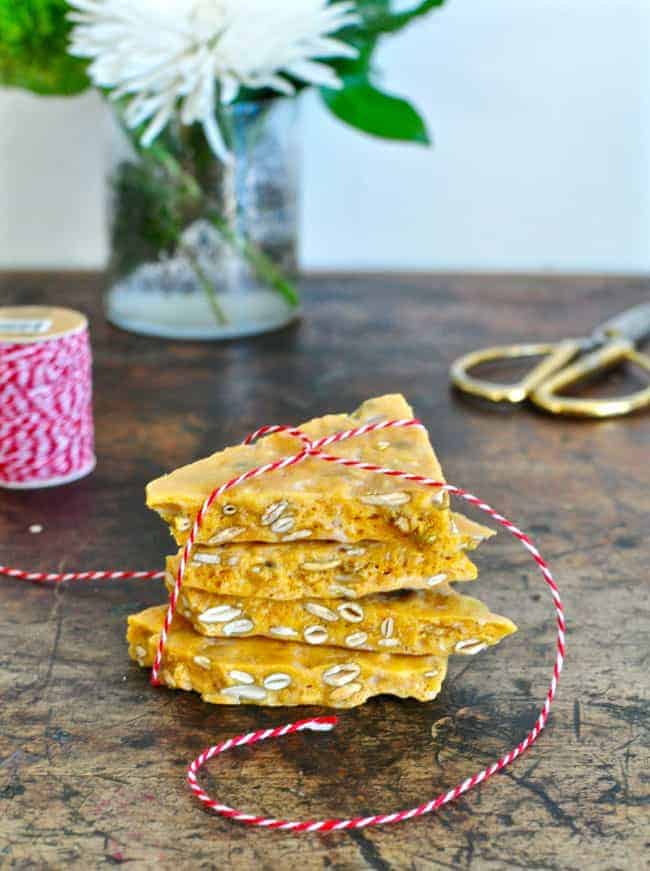 Crunchy coconut pumpkin seed brittle made with coconut oil, flakes of coconut, and pumpkin seeds; a delicious twist on classic peanut brittle candy.