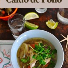 An overhead image of a bowl of chicken soup with a text overlay that says Slow Cooker Caldo de Pollo