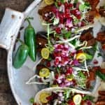 Slow roasted achiote beef is a perfect match for the bright and sunny pomegranate and jalapeño salsa in these achiote beef tacos. Gluten and dairy free!