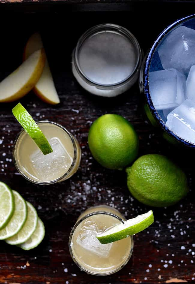 This Apple Lime Margarita has tequila, fresh-squeezed lime juice, and pressed apple cider syrup and is a cold-weather twist on this classic summer cocktail.