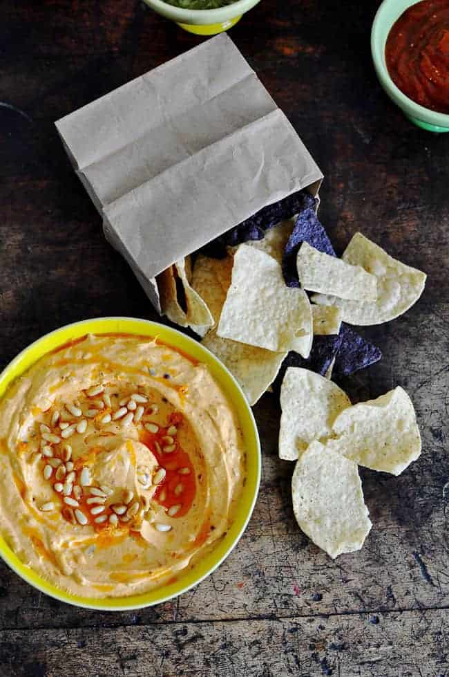 A whipped goat cheese dip recipe with a homemade, spicy cascabel chile-garlic oil, toasted pine nuts, and fresh orange zest. One of my most popular dips!