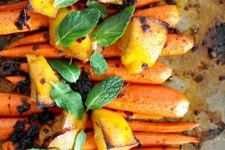 Sweet roasted carrots tossed in a chipotle and honey butter and sprinkled with fresh mint leaves. Gluten-free!
