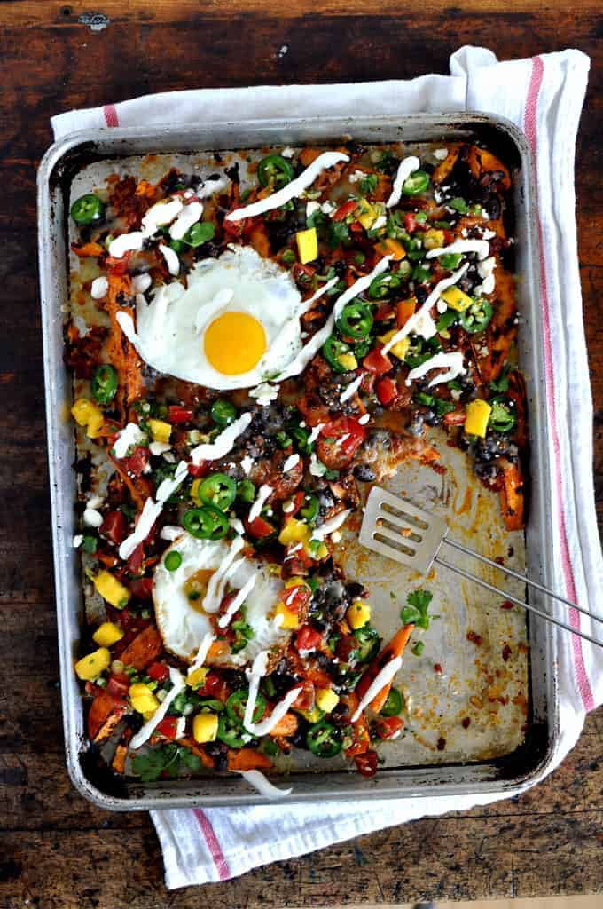 The ultimate breakfast nachos with roasted sweet potatoes, chorizo, black beans, cheddar, & eggs. Served with queso fresco, sour cream, and margarita salsa.
