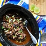 Slow cooker carne adobada just might be your new favorite way to cook a roast. Covered in adobo sauce and slowly simmered until tender its just delicious!