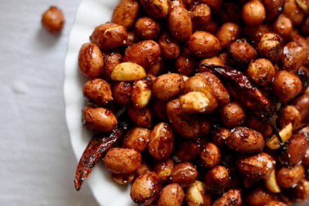 These chili lime roasted peanuts are tossed in an addictive mixture of chili, fresh lime zest, turbinado sugar, and salt then roasted to a golden brown.