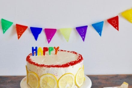 A pretty double layer lemon cake recipe with honey-chamomile frosting and raspberries. Perfect for any spring celebration. Almost vegan (minus the honey).