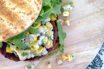 Grilled stuffed burger filled with feta & topped with Esquites (Mexican-style sweet corn tossed with creamy mayo, jalapeños, lime, scallions, and cayenne).