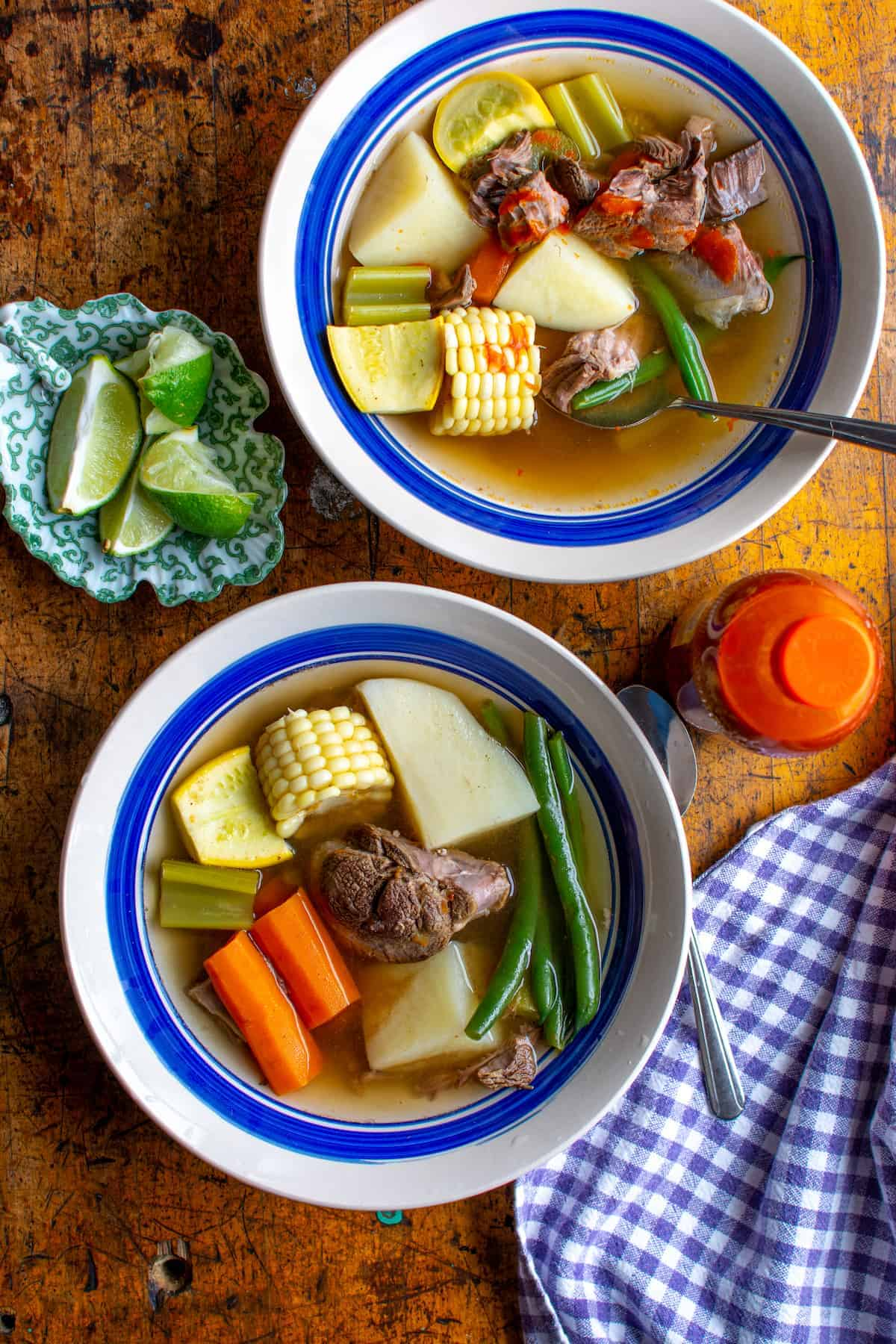This Caldo de Res {Beef and Vegetable Soup} is pure comfort food with tender beef, carrots, potato, and squash all simmered in a rich broth. #caldoderes #mexicansoup #caldorecipe #beefcaldo