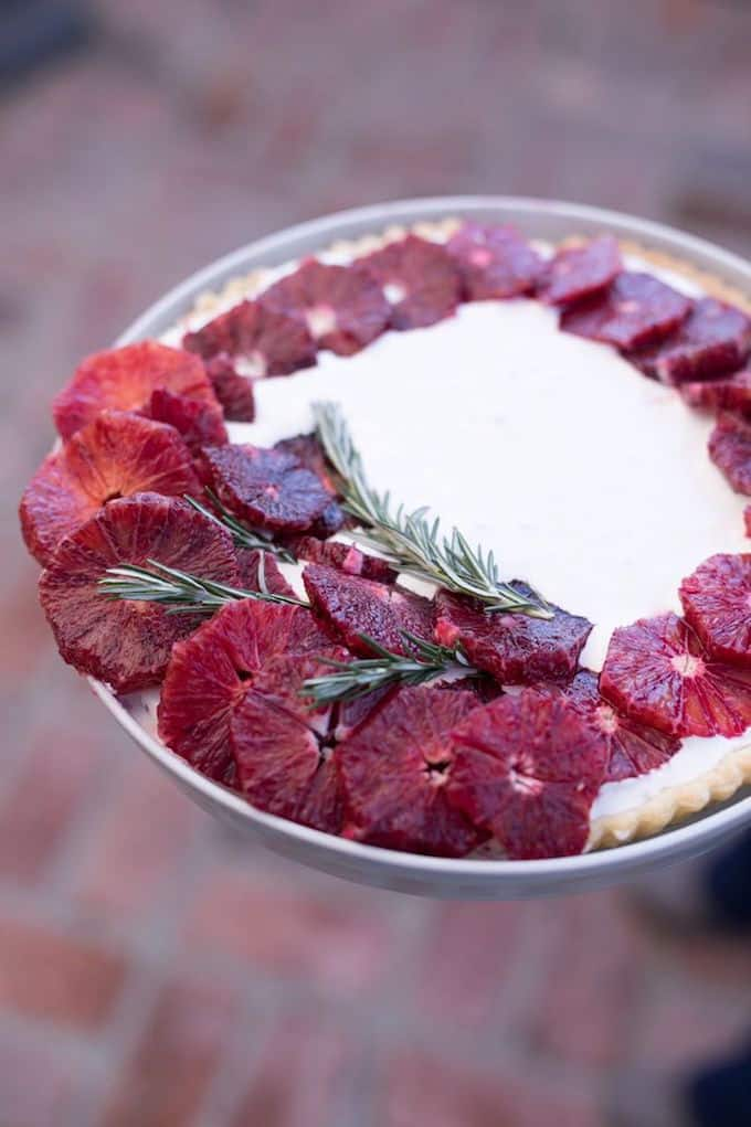 Blood Orange Tart with Vanilla Mascarpone, sliced blood oranges, and rosemary on top.