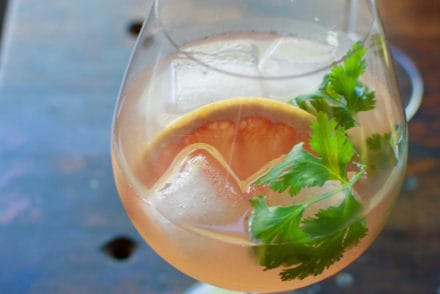This pink grapefruit Spanish gin tonic is an ultra-refreshing sipper for summer. Flavored with cilantro-grapefruit syrup and a hefty splash of tonic.