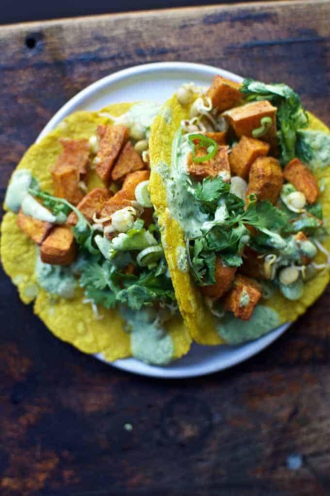 Sweet potato and lentil tacos made with roasted sweet potatoes, DIY sprouted lentils, & jalapeño yogurt salsa wrapped in homemade sprouted lentil tortillas.