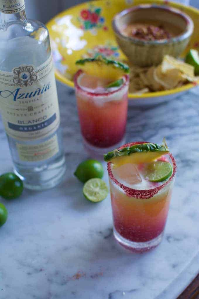 This Pineapple Hibiscus Margarita is made with fresh pineapple puree, organic blanco tequila, and hibiscus syrup. Perfect to celebrate Cinco de Mayo!