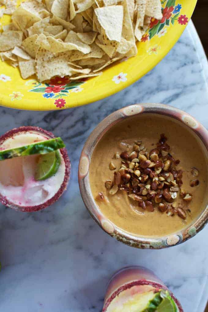 Salsa de Cacahuate is a creamy, spicy salsa made from ground peanuts, arbol chiles, charred tomatoes, garlic, & onions. Goes amazing with margaritas!