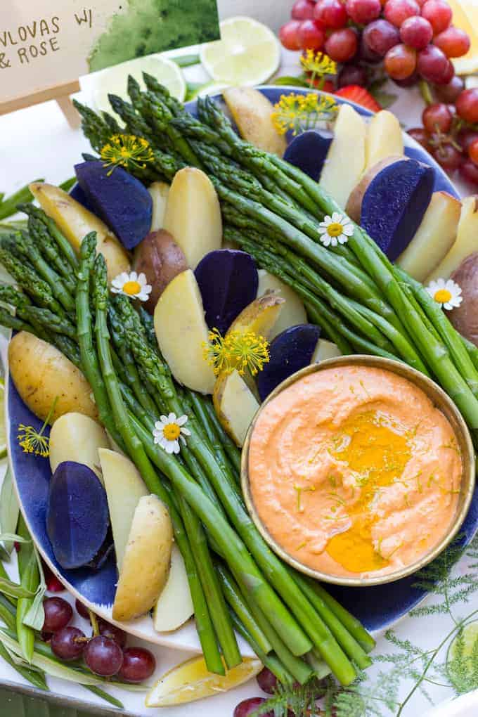 Learn how to make homemade harissa then use it in this creamy Harissa Goat Cheese Dip; perfect for tender asparagus spears and summer's first new potatoes.