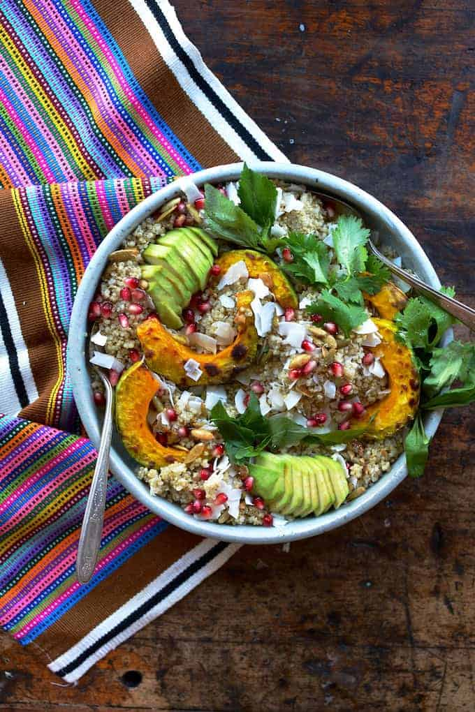This coconut quinoa makes an excellent holiday side or vegan main dish with fluffy quinoa, big flakes of coconut, toasted pumpkin seeds, and roasted squash.