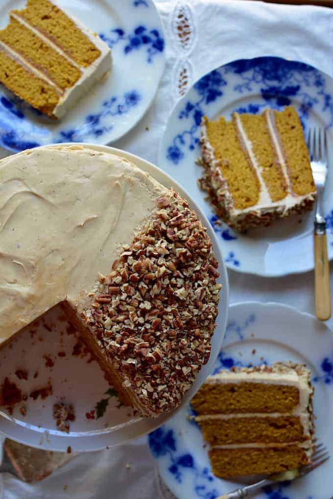 Pumpkin Layer Cake; Triple decker, rum-spiked pumpkin cake filled with dulce de leche and covered with brown butter-cream cheese frosting and topped with toasted pecans.