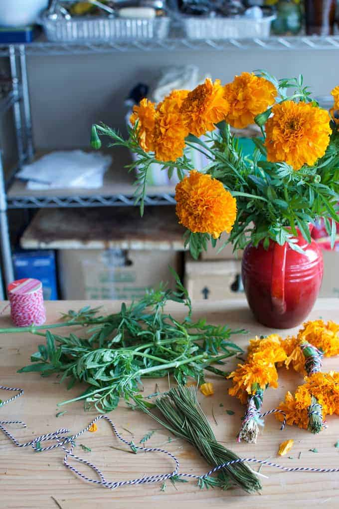 How to make marigold smudge sticks to cleanse your environment and prepare your home to welcome loved ones for Day of the Dead celebrations.