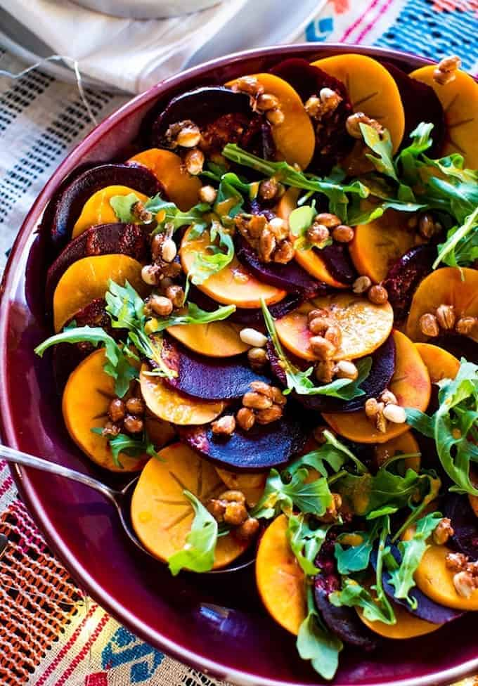 A colorful winter beet and persimmon salad bursting with all the flavors of the season; citrus in the dressing, smoky paprika, and spicy maple candied peanuts for texture and crunch. Vegan and gluten-free!