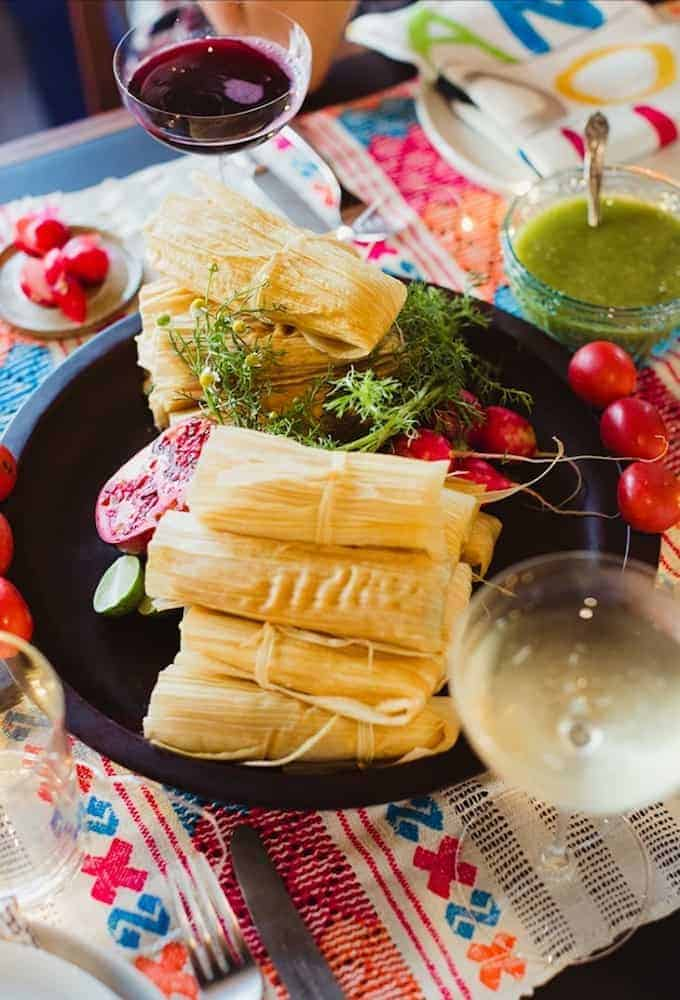 These tahini Potato and Kale Tamales are a vegan tamale that doesn't skimp on flavor. Fluffy masa surround a filling of tahini-garlic potatoes and kale.