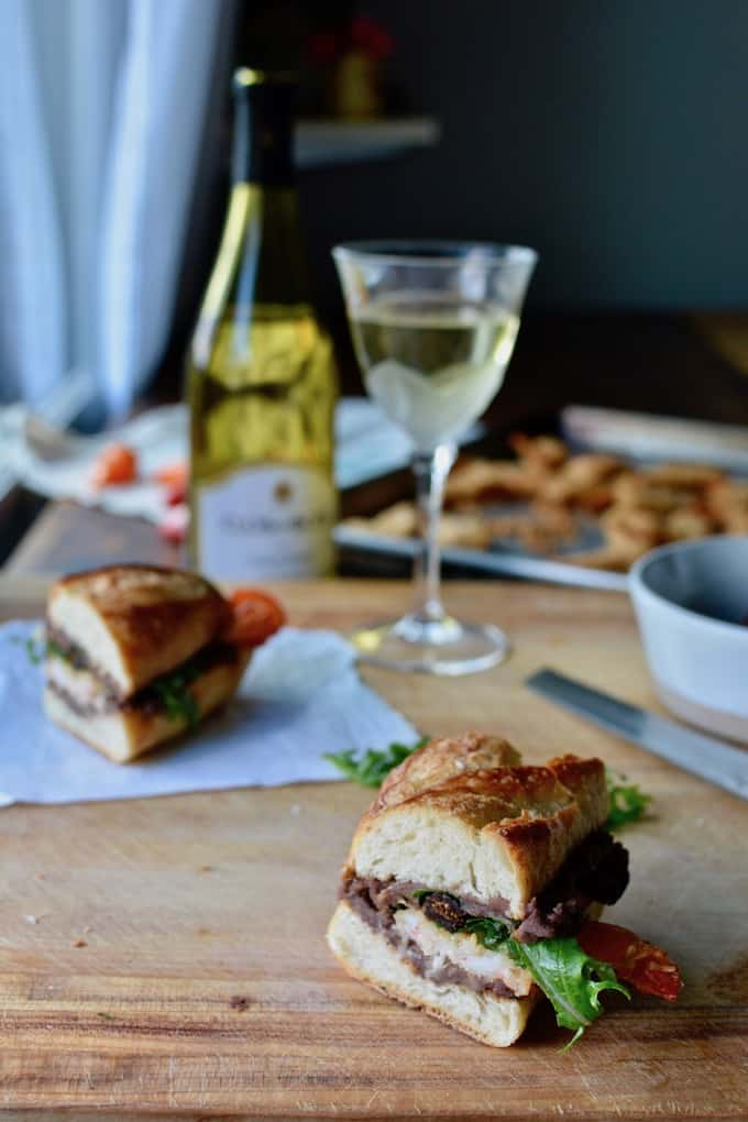 This Coconut Shrimp Torta is a super easy Mexican-style sandwich with baked coconut shrimp, refried black beans, and a baby kale, fig, scallion, bell pepper salad all on toasted bread. Serve with a chilled glass of wine for a relaxing weeknight meal everyone will love. #easyMexicanRecipe #TortaMexicana #shrimprecipe #healthyLatinfood