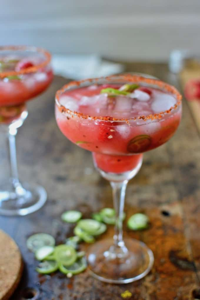 This Spicy Raspberry Jalapeño Margarita made in honor of #MargaritaWeek is a fruity, fiery blend of sweet raspberries, fresh jalapeños, tequila, and lime juice that can easily be made into a boozy, big-batch cocktail for Cinco de Mayo or any celebration. #margarita #spicymargarita #cincodemayo #margaritarecipe