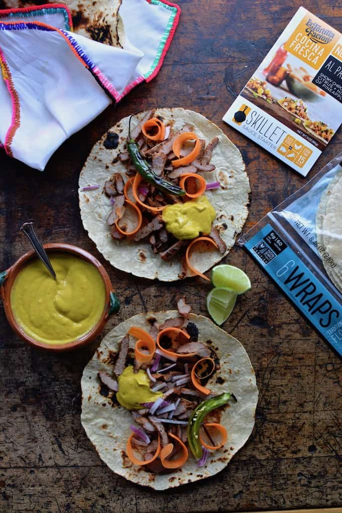 Tacos arabes or Arabian tacos are made with thin slices of grilled pork, seasoned with cumin, chipotle, and garlic, topped with a smooth, sweet, and spicy carrot and avocado crema all wrapped up in a soft flour tortilla or pita bread. Like a gyro, but in taco form. #tacos #healthyMexican #porktacos #tacorecipe