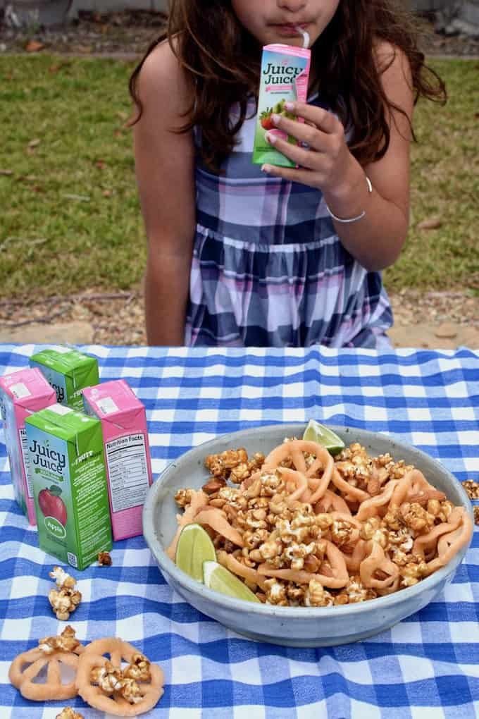 Chicharrones de harina are Mexican wheat crisps that puff and crisp as you fry them. They go by many names but make a perfect salty compliment to sweet caramel corn and nuts in this snack mix. #chicharronesdeharina #healthyMexican #healthysnack #healthycarmelcorn