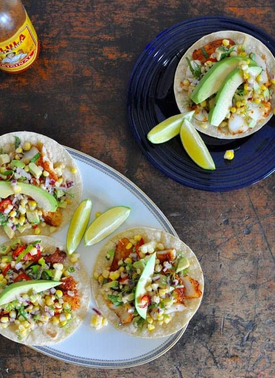 Summer taco are the best! Here are 7 recipes to celebrate everything glorious about summer, in taco form. From Farmer's Market produce to perfectly grilled meats, and lots of fresh salsas. #tacos #tacorecipes #veggietacos #fishtacos #healthyMexicanfood