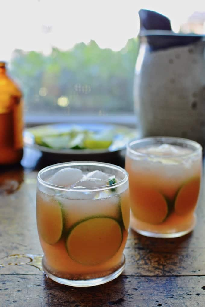 The Tequila Libre cocktail embraces the free-flowing spirit of summer with tequila, ginger beer, and homemade pink rhubarb lemonade. #cocktailrecipe #tequila #summercocktail #lemonade