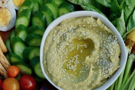 This Roasted Tomatillo and Avocado Hummus is a fluffy, airy dip rich with ripe avocado instead of loads of olive oil, charred tomatillos, and serrano chiles. #hummus #avocadohummus #healthyMexican #diprecipe #hummusrecipe
