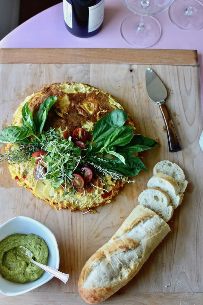 A classic egg-potato Spanish Tortilla with a major vegetable upgrade of cauliflower, bell peppers, and onions plus an grassy green version of Romesco sauce. #spanishtortilla #romescosauce #outgrowordinary #CascadianFarm #feedfeed #ricedcauliflower