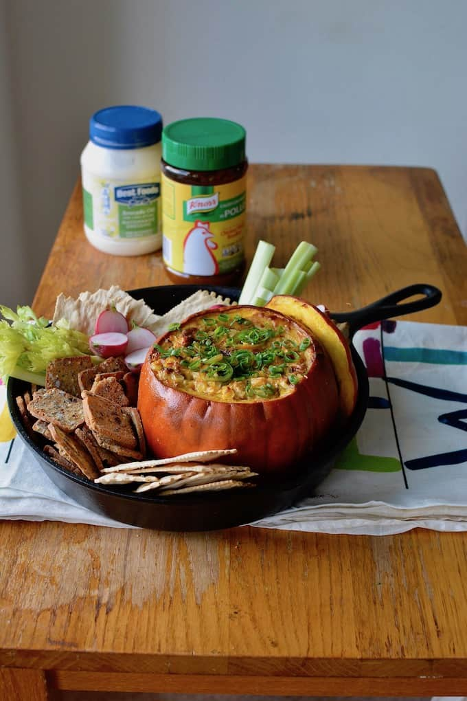 This Mexican Street Corn Dip baked in a pumpkin is our new go-to appetizer for fall. Creamy, cheesy corn with layers of spice is delicious and adorable too! #Mexicanstreetcorn #elotes #corndip #pumpkin #fall #streetcorndip #hotcorndip