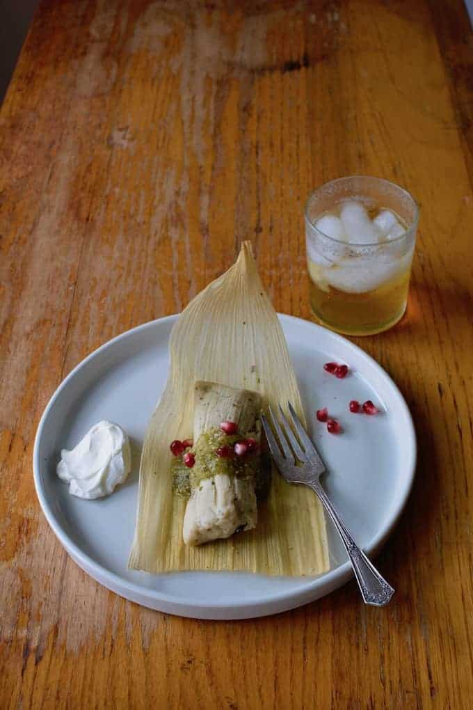 Tender beef, slowly roasted with apples, apple juice, and chiles make the most delicious braised beef tamales. Learn how to make them for Day of the Dead! #tamales #beeftamales #dayofthedead #diadelosmuertos