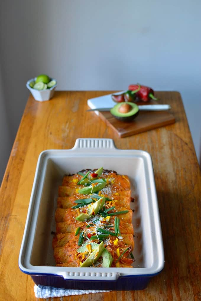 These root vegetable enchiladas have all the feels of a colorful fall harvest. Bathed in a smoky chipotle cream sauce they are the perfect cozy fall dinner. #enchiladas #vegetarianenchiladas #rootvegetables #cascadianfarm #thefeedfeed #easyenchiladas