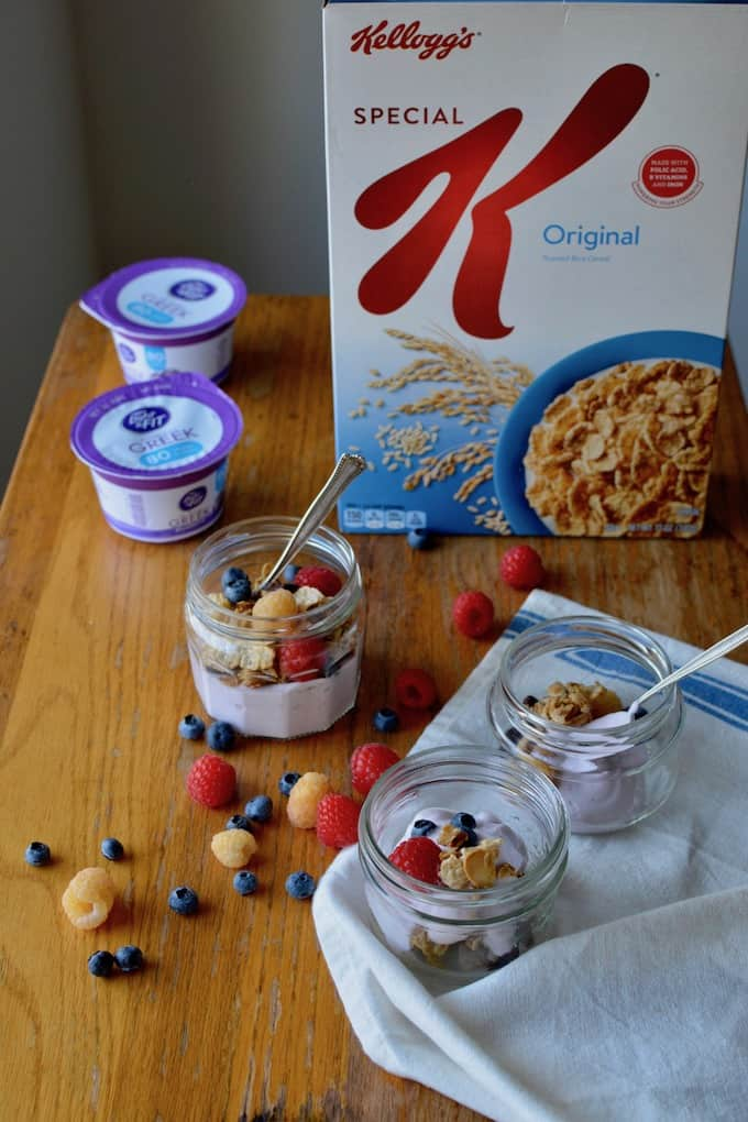 This super simple granola recipe is made right on the stove top in under 10 minutes. It has almonds, oats, a bit of ginger, and Kellog's Special K cereal to make it extra crisp. Layer with Greek yogurt and fresh berries for a healthy breakfast when you need something fast. #ad #granola #easygranola #yogurt #yogurtparfait #easybreakfast #healthybreakfast