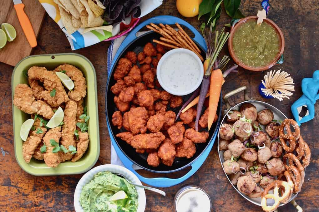 Seven strategies for hosting a stress-free Game Day party. Because chilling and watching the big game with friends is supposed to be relaxing. Don't freak out over the perfect football-shaped cake, pick up some store-bought apps, make a few easy dips, then just sit back and enjoy the game! #SuperBowl #easysuperbowlparty #SuperBowlPartyIdeas #gameday